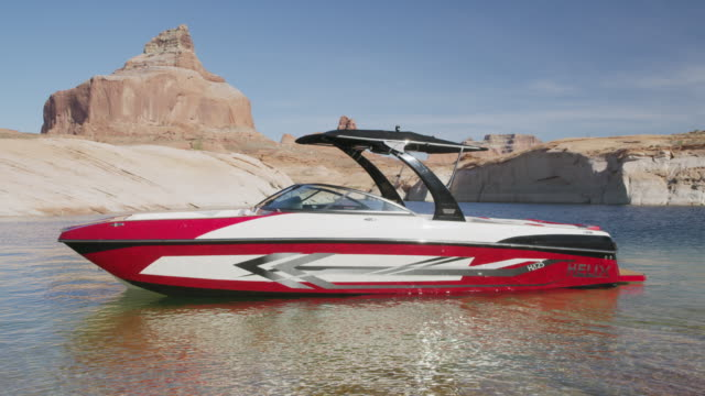 wide shot of empty speedboat anchored in lake / lake powell, utah, united states - anchored stock videos & royalty-free footage