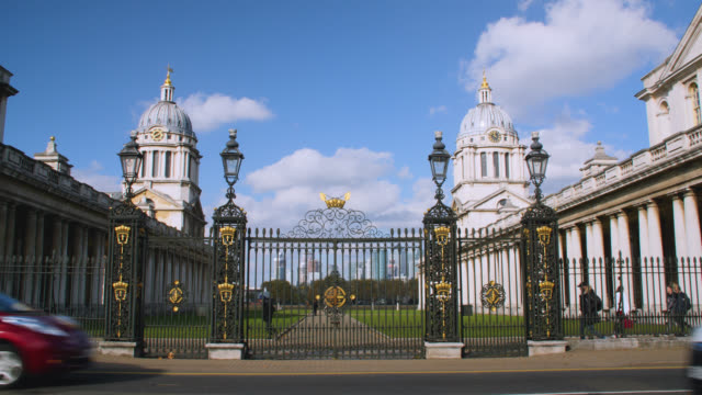 wide shot of entrance to the old royal naval college in greenwich with the isle of dogs in the background - royal navy college greenwich stock videos & royalty-free footage