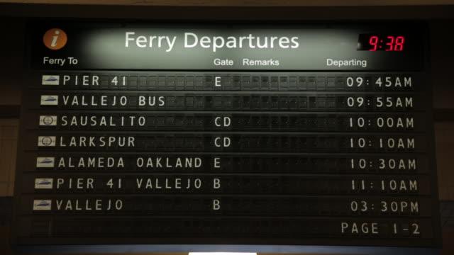 vídeos y material grabado en eventos de stock de wide shot of ferry departures sign - tabla de llegadas y salidas