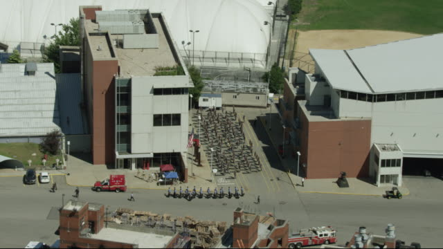 wide shot of firefighter trainees marching and exercising at the fire department of the city of new york training center - fire department of the city of new york stock videos and b-roll footage