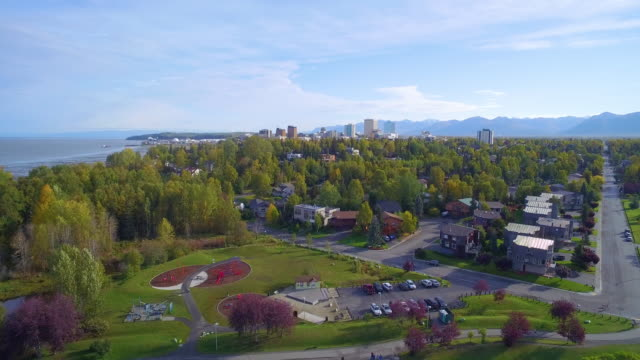 wide shot of flying towards downtown anchorage from westchester lagoon - anchorage alaska stock videos & royalty-free footage