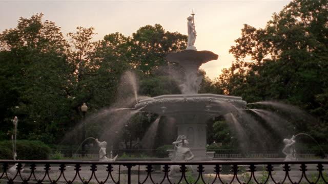 Wide shot of Forsyth Park Fountain at dusk / Savannah, Georgia