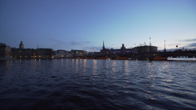 wide shot of gamla stan, the old town, of stockholm with water - スウェーデン点の映像素材/bロール