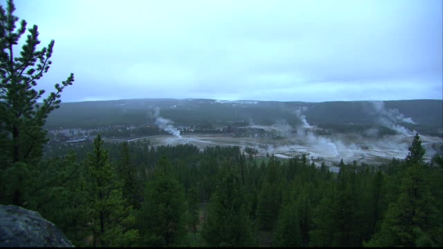wide shot of geysers at yellowstone national park in wyoming. - yellowstone national park stock videos & royalty-free footage