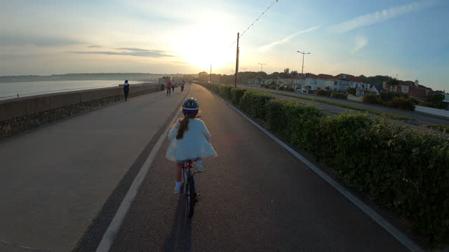 wide shot of girl cycling - channel islands england stock videos & royalty-free footage