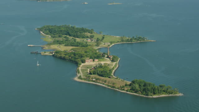 wide shot of hart island with abandoned buildings - hart island stock videos & royalty-free footage