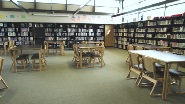 wide shot of high school library - library stock videos & royalty-free footage