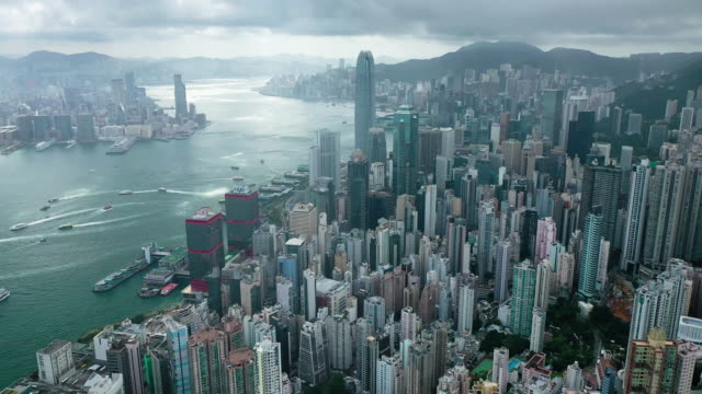 wide shot of hong kong cityscape real time aerial view - victoria harbour hong kong stock videos & royalty-free footage