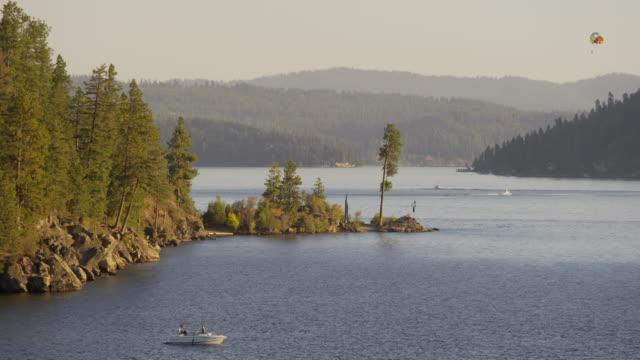 wide shot of hot air balloon and boats at lake / coeur d'alene, idaho, united states - idaho stock videos & royalty-free footage