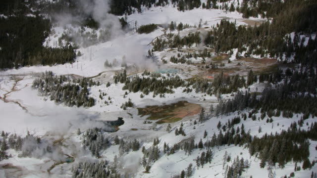 wide shot of hot springs in the yellowstone national park at winter - hot spring stock videos & royalty-free footage