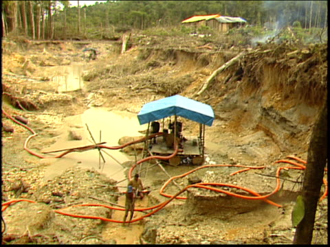 wide shot of hydraulic mining at a gold mine in the amazon - roraima state stock videos and b-roll footage