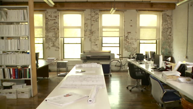 wide shot of interior of empty office. dolly to the left. - office chair stock videos & royalty-free footage