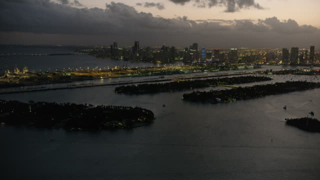 Wide shot of islands in Biscayne Bay with Downtown Miami in the background at night