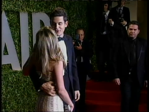 wide shot of john mayer and jennifer aniston on the red carpet at the vanity fair oscar party after the 81st academy awards on february 22, 2009.... - oscar party stock videos & royalty-free footage