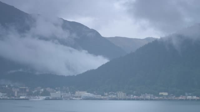 wide shot of juneau cityscape with a mountain in the background - juneau stock videos and b-roll footage