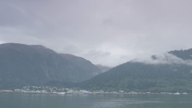 wide shot of juneau cityscape with mountains in the background - juneau stock videos and b-roll footage
