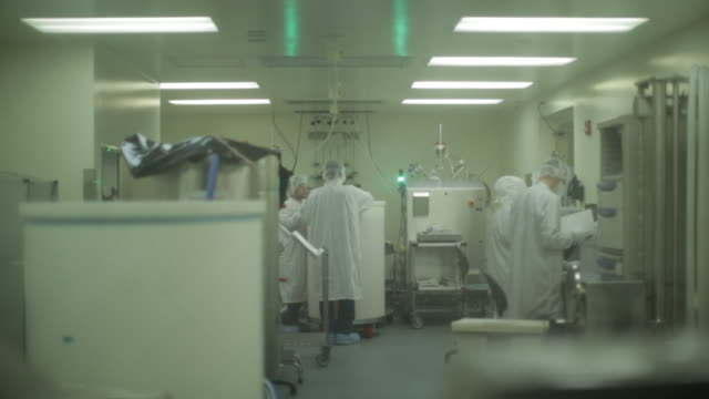 wide shot of laboratory workers working in a medical lab - biotechnology stock videos & royalty-free footage