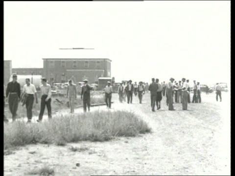b/w wide shot of large group of men walking toward camera / sound - wpa stock videos & royalty-free footage
