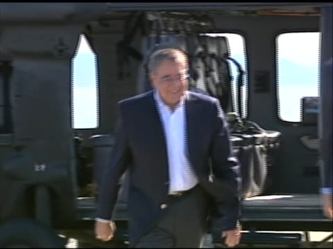 wide shot of leon panetta exiting a helicopter and greeting military personnel after landing in tokyo. this footage took place during panetta's first... - (war or terrorism or election or government or illness or news event or speech or politics or politician or conflict or military or extreme weather or business or economy) and not usa点の映像素材/bロール