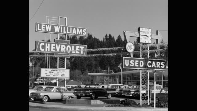 wide shot of lew williams chevrolet car dealership, eugene, oregon, usa - car showroom stock videos & royalty-free footage