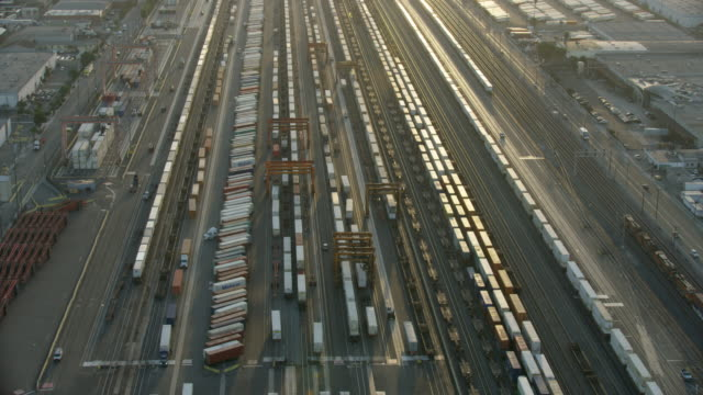 wide shot of los angeles intermodal facility in hobart at sunrise - economy stock videos and b-roll footage