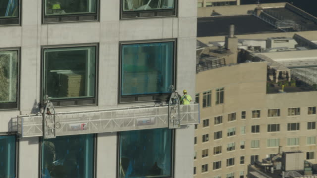 Wide shot of maintenance staff working at the 432 Park Avenue