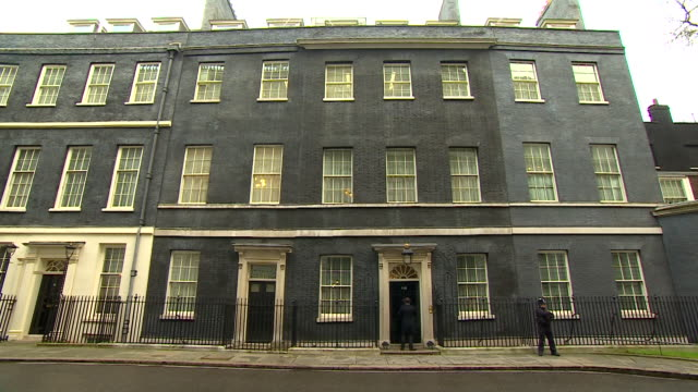 wide shot of male entering number 10, downing street - erkerfenster stock-videos und b-roll-filmmaterial