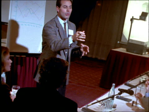 wide shot of man talking to audience at business seminar - suit stock videos and b-roll footage