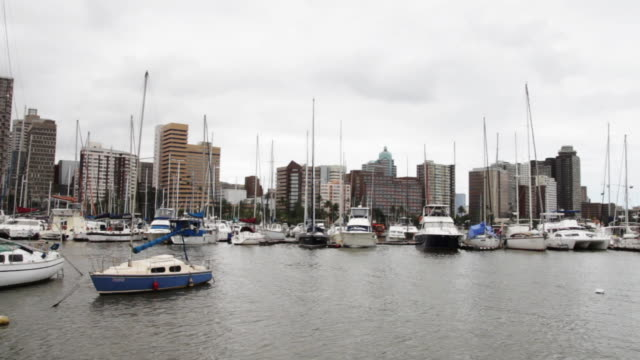 wide shot of marina and durban skyline - durban stock videos & royalty-free footage