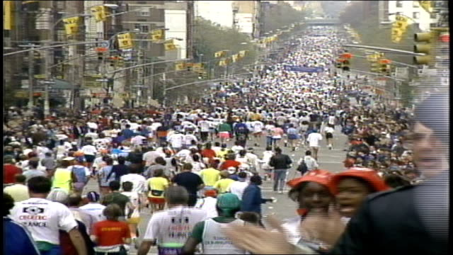 Wide Shot of Mass of Runners On Street