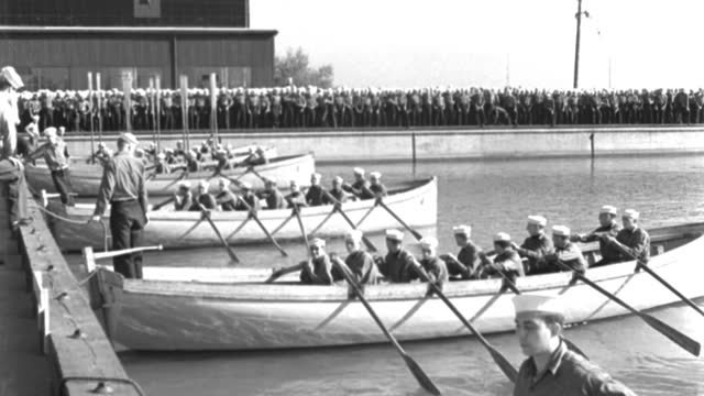 wide shot of men in uniforms sitting in whaleboats at basin dock before boat race - 1944 stock videos & royalty-free footage