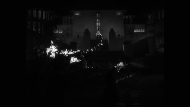 wide shot of men walking with flaming torches at night - flaming torch stock videos & royalty-free footage