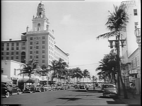 wide shot of miami beach street / montage of tourists waiting in line outside of a train station for special north bound trains people at long ticket... - fuel crisis stock videos and b-roll footage