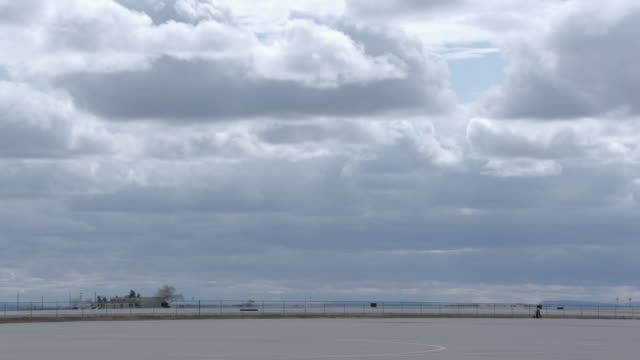 wide shot of military base against cloudy sky. - military base stock videos & royalty-free footage