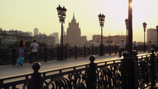 wide shot of moscow's church, christ the savior cathedral, with tourists on bridge.  - onion dome stock videos and b-roll footage