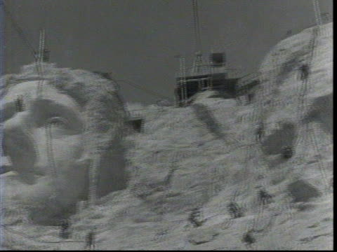 wide shot of mount rushmore under progress / monument carving washington's face is complete / monument carving of jefferson's face is mostly done /... - thomas jefferson stock videos & royalty-free footage