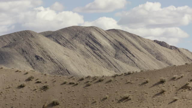 wide shot of mountains at nevada test site - weapons of mass destruction stock videos & royalty-free footage