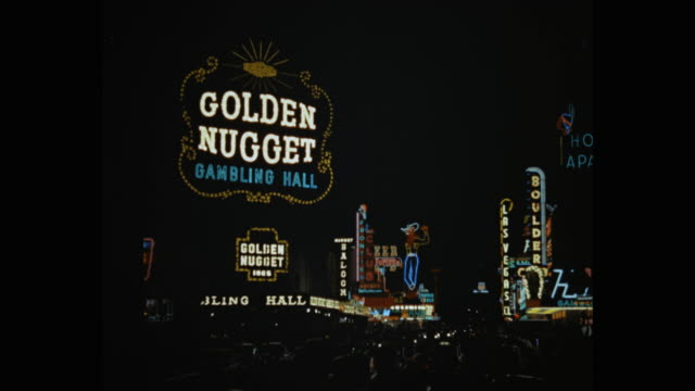stockvideo's en b-roll-footage met wide shot of neon signs on las vegas street at night, nevada, united states of america - capital letter