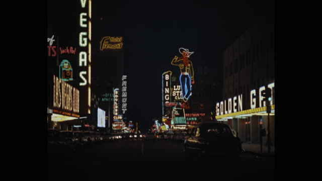wide shot of neon signs on las vegas street at night, nevada, usa - casino sign stock videos & royalty-free footage