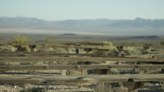wide shot of nevada test site with atomic testing observation benches - massenvernichtungswaffe stock-videos und b-roll-filmmaterial