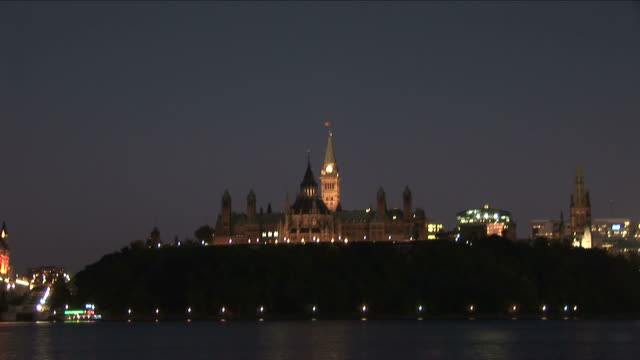 Wide shot of Parliament Hill at night in Ottawa Canada