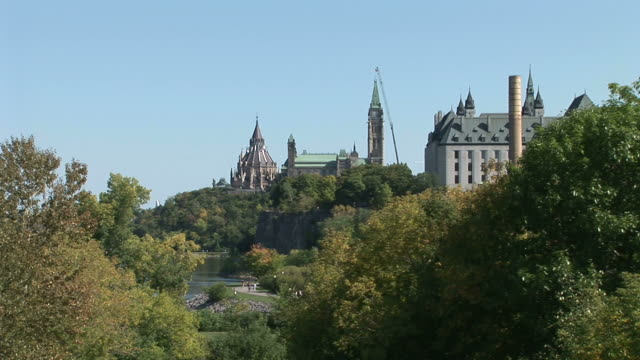 wide shot of parliament hill in ottawa canada - rideau canal stock videos & royalty-free footage