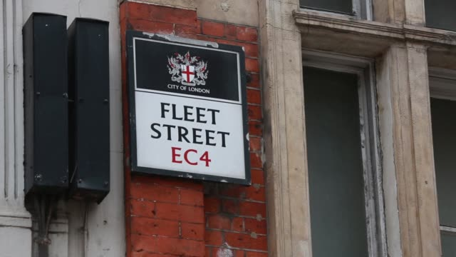 wide shot of pedestrians and traffic on fleet street in london on wednesday november 26 the spiral of st brides church fleet street roadsigns gvs of... - road sign stock videos & royalty-free footage