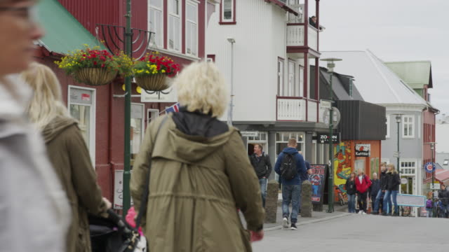 wide shot of people walking in busy city / reykjavik, iceland - reykjavik stock videos and b-roll footage