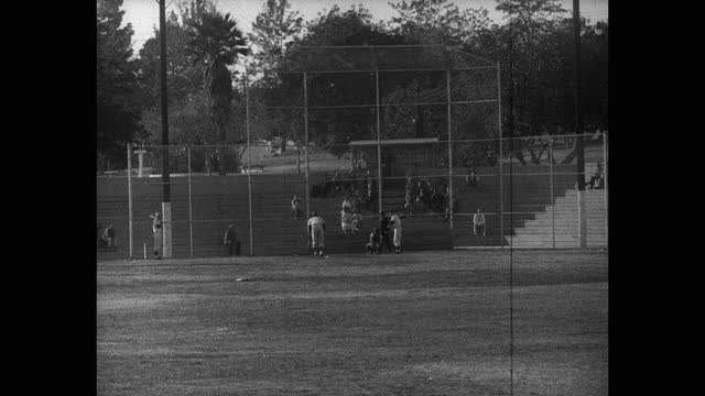 wide shot of people watching baseball players playing game on baseball field - 20 seconds or greater stock videos & royalty-free footage