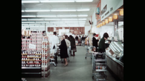 wide shot of people with shopping carts shopping in super market - cabinet stock videos & royalty-free footage