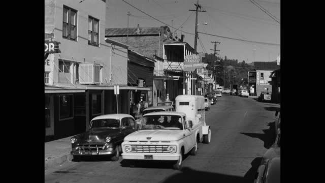 wide shot of pick-up truck driving on street with buildings against sky in small town, sonora, california, usa - 1965 stock videos & royalty-free footage