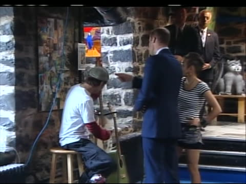 wide shot of prince william checking out a guitar at maison dauphine, a youth center in quebec city. the duke and duchess visited the youth center in... - music or celebrities or fashion or film industry or film premiere or youth culture or novelty item or vacations stock videos & royalty-free footage