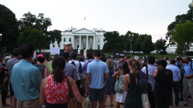 wide shot of protesters with a papier mache trump puppet outside of white house - papier stock videos & royalty-free footage