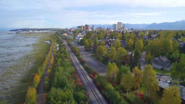wide shot of railroad tracks running through anchorage - anchorage alaska stock videos & royalty-free footage